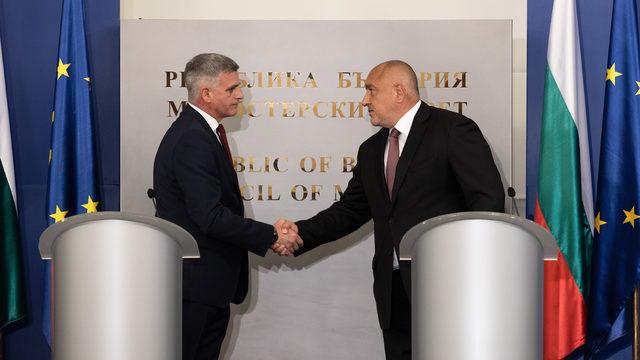 Outgoing Prime Minister Boyko Borissov (right) passes the baton to Stefan Yanev