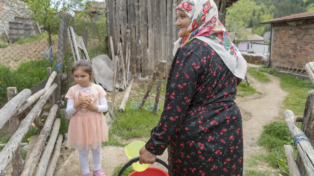 Sabie Djikova with her granddaughter, 5 year-old Sabie in the yard behind the house that is shared by three generations in the Muslim majority village of Ablanitsa. The family keeps three cows as well as rabbits and a horse.