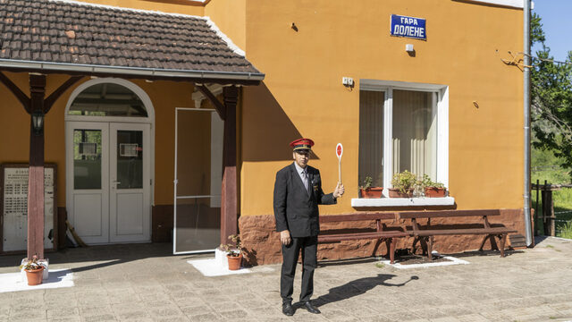The station master stops an incoming train at Station Dolene. Station masters not only direct the incoming trains but are also in phone communication with other station masters, giving signals to let each other know whether or not it's alright to send the train onwards.