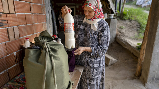 """Nearly every day, Sabie Djikova carries 20 liters of fresh milk from her home in Ablanitsa to the station Tsvetino. She boards the train to Velingrad. In Velingrad, she makes home deliveries before returning back later in the morning. I carried 30 or 40 when I was younger,"""" she says."""