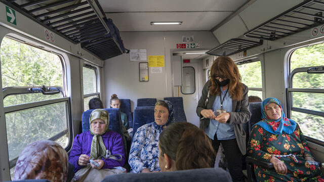 A train conductor checks rail passes and sells tickets to a group of women heading home by train from Velingrad after selling their milk and other products. Sabie gets a pensioner's discount and pays 216 BGN per year.