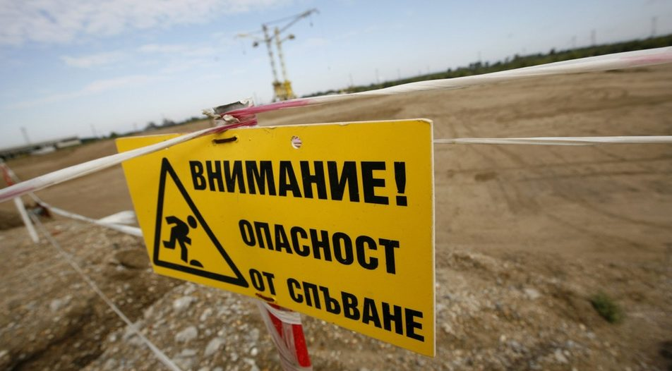 A warning sign is seen in front of the construction site of Bulgaria's second nuclear power plant in the town of Belene