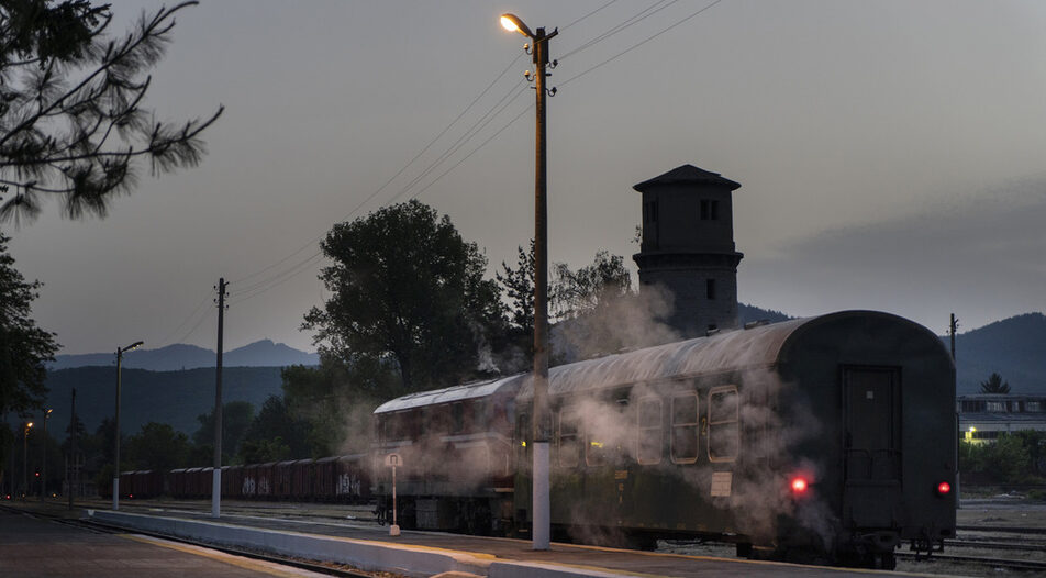 Steam is expelled from the train's heating system as the day's first train is being prepared for departure from station Velingrad for a 5:55 departure.
